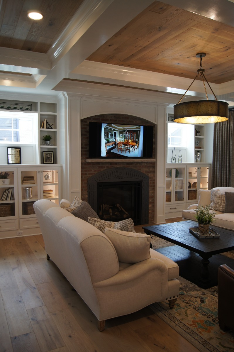 wood ceiling with brick tv wall mount